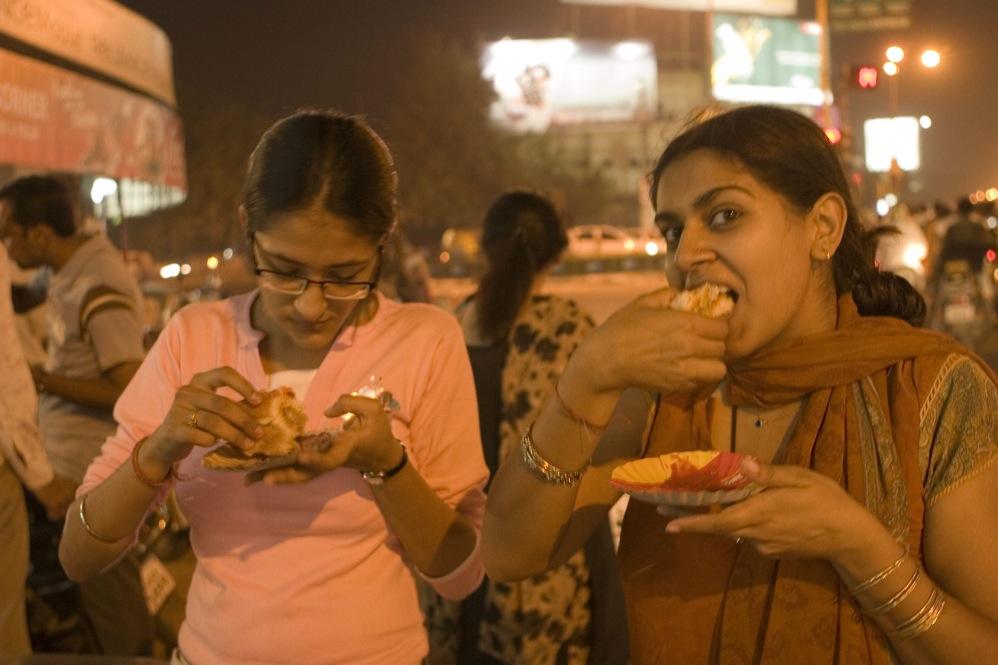 Man Eating Standing Street Food
